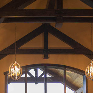 Great Room with large pendant lighting and wood beams
