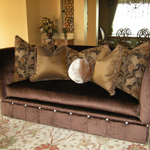 Marge Carson sofa featuring 110-tufted crystal buttons