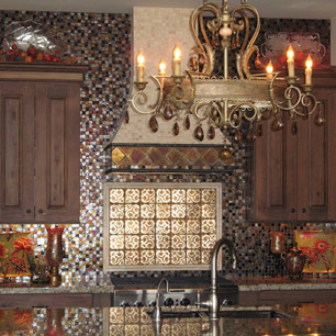 Kitchen featuring granite, chandelier and tile