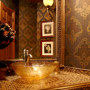 Powder Room with tile, wallpaper, sconce and chandelier lighting and tiled mirror