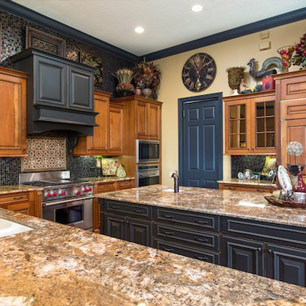 Kitchen featuring granite and tile