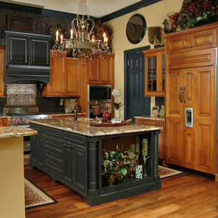 Kitchen featuring granite, chandelier lighting and tile