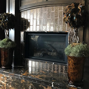 Fireplace featuring tile and marble