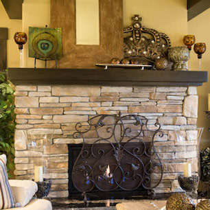 Stone fireplace with granite hearth and accessories