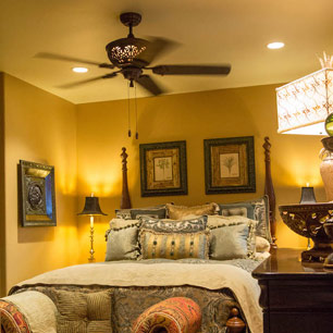 Guest bedroom with carpet, luxury bedding and accessories