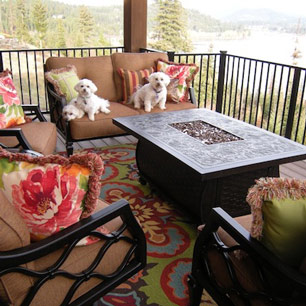 Outdoor Living featuring furniture, area rug pillows and fire table